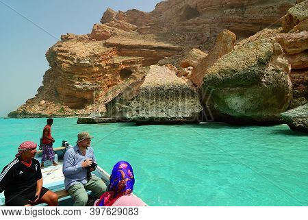 Socotra, Yemen - March 08, 2010: Tourists Look On The  Beautiful Coastline And Cliff Of The Ras Shua