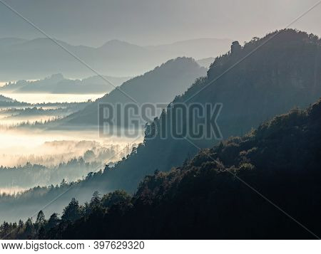 Dark Green Mountain Forest Landscape. Foggy Mountain Forest In Valley. Fantastic Misty Landscape In