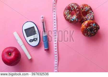 Diabetic Measurement Tools, Insulin And Donuts On Pink