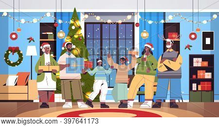 African American Multi Generation Family In Santa Hats Holding Gifts New Year Christmas Holidays Cel
