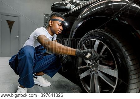 Washing A Car By Hand, Car Detailing. Close Up Image Of Professional African Male Worker, Cleaning T