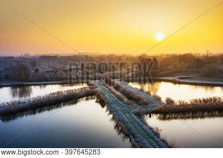 Beautiful sunrise over the frosty canals in Pruszcz Gdanski, Poland.