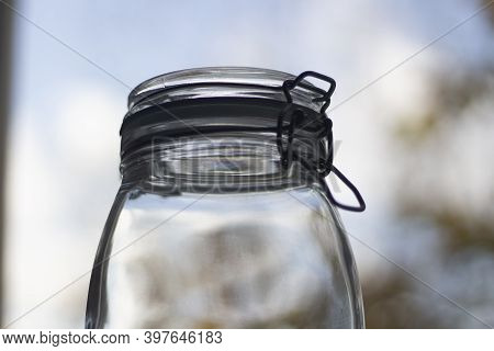 Glass Jar. Jar For Storing Spices. Clear Glass. Jar With A Vacuum Lid.