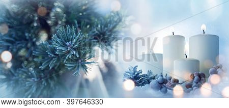 Candles With Fir Branches In The Winter Sunlight. Frozen Christmas Decoration With Festive Bokeh. Ba