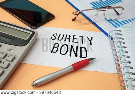 Office Desk With Documents, Concept Image For Blog Headline Or Header Image. Surety Bond Inscription