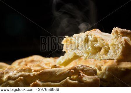 Slice Of Freshly Baked Apple Pie On Metal Plate, Closeup