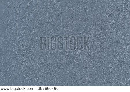Gray creased leather textured background