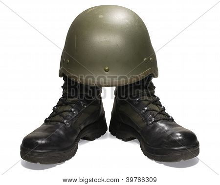Soldier: military boots and helmet. Isolated on white. Clipping path