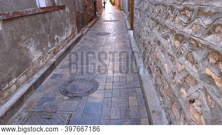 Old Cobbled Street Of An Ancient City At Turkey. Narrow Street And Historical Architecture Of Old To