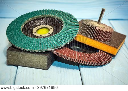 Kit Abrasive Tools And Sandpaper Different Colors On Vintage Wooden Background