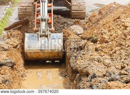Backhoe Dig Repair Broken Water Line Pipe Main Plumbing On Road