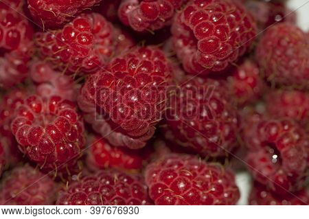 Raspberry Background. Fresh Big Bright Appetizing Raspberry. View From Above. Macro Photo Of A Raspb