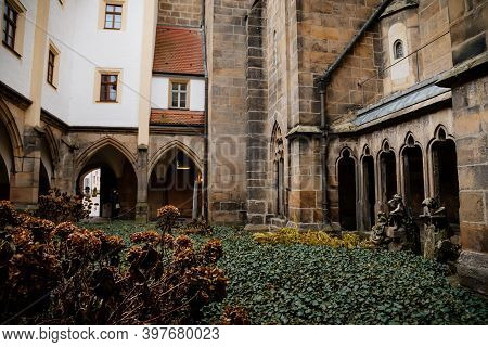 The Inner Courtyard Inside Medieval Gothic Meissen Cathedral (meissner Dom), Stone Arches And Sculpt