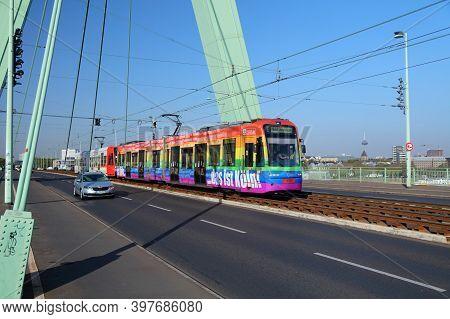 Cologne, Germany - September 21, 2020: Public Transportation Electric Tram Crosses Severins Bridge I