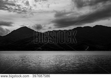 View Of Landscape Nature In Sky And Cloud Storm And River In Stormy Rain Season, Black And White And
