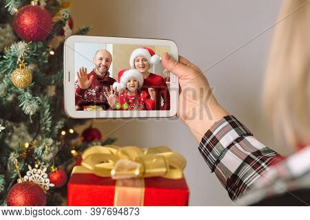 Children Congratulate Their Parents Via Video Conference. A Woman Holds A Digital Tablet In Her Arms