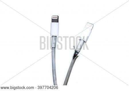 The Broken And Frayed Cable From The Charger For The Smart Phones. Typical Problem Of The Users. Com