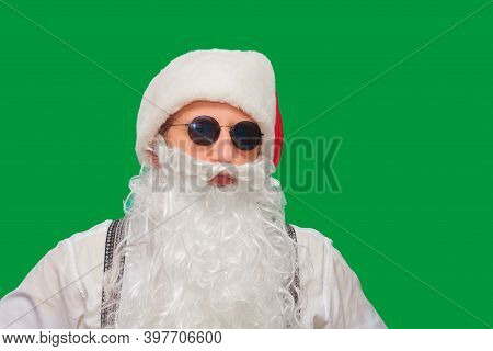 Portrait Of Stylish Santa Claus On Color Background.
