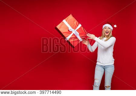 Christmas Concept Photo Of Thrilled Woman In Red Background