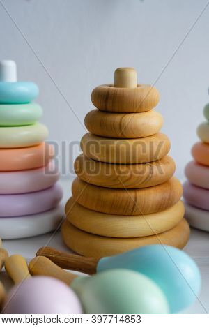 Colorful Maracas And A Pyramid For A Child. Childrens Room. Wooden Toys For Toddlers.