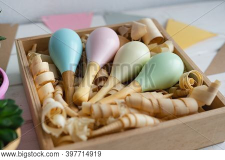 Colorful Maracas In A Wooden Box With Shavings. Wooden Rattles For Toddlers. Childrens Safe Toys. Th