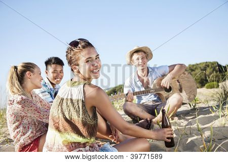 group of young people having a good time outdoors