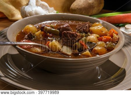 Slow Cooker Beef And Vegetables Soup With Potatoes And Pearl Onions