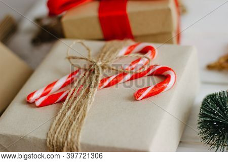 Christmas Gifts With Candy Canes. Holiday Card. Craft Boxes With Gifts. Christmas Composition. Selec