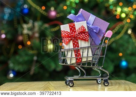 Grocery Shopping Cart With  Wrapped Holiday Gift Boxes Inside. Christmas Family Shopping Concept