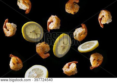 Stir Frying And Tossing Shrimp With Sliced Lemon Concept