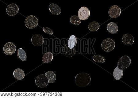 Falling Coins On A Black Background, 50 Euro Cents. Isolated. Space For Text. European Money.