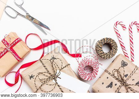 Eco Wrapping Of Gifts For Christmas And New Year. Boxes, Striped String, Ribbons, Scissors, Labels,