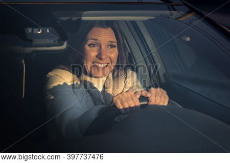 Woman Afraid To Drive A Car. The Fear Of Driving. First Time Learns To Drive Automobile. Fear Of Dri