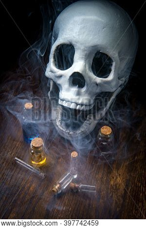 Witches Magic Potion Poison Bottles With Vapors And Human Skull