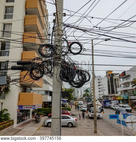 Cartagena, Columbia - November 5, 2019: A Typical Electrical Pole With A Mess Of Wires  That Is All