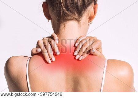 Closeup Shot Of Woman From Back Having Red Spot Of Neck Pain. Neck And Shoulder Pain And Injury Or M
