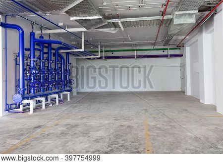 Parking Garage Interior, Industrial Building, Hydrant With Water Hoses And Fire Extinguisher Equipme