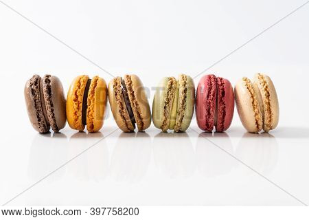 Traditional French Colorful Macarons In A Rows, Top View