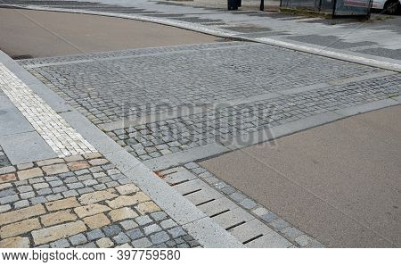 The Edge Of The Road Is Drained By Longitudinal Channels Of Granite Grids With Gray Slits At The Dec
