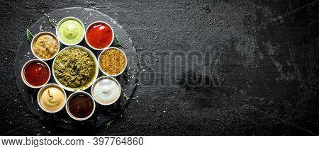 Pesto Sauce, Tomato Sauce, Barbecue Sauce, Mustard, Mayonnaise, Guacomole Sauce On A Stone Board. On