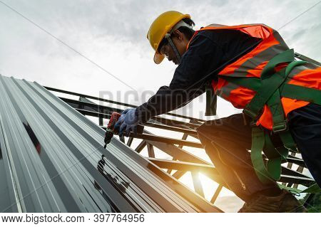 Roof Construction, Asian Worker Install New Roof, Roofing Tools Electric Drill Used On New Roofs Wit