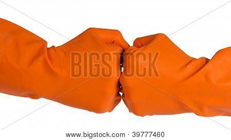 Two Fists In Orange Gloves