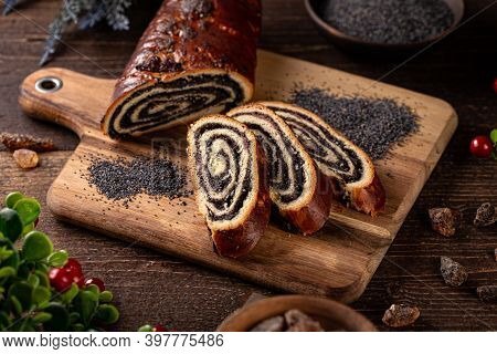 Poppy Seed Rolls, Traditional Hungarian Chistmas Beigli Cake On Wooden Board