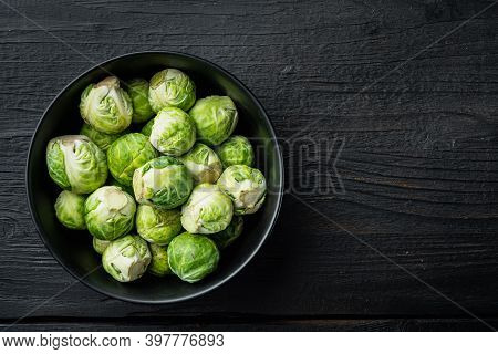 Brussels Sprouts, On Black Wooden Table, Top View With Space For Text