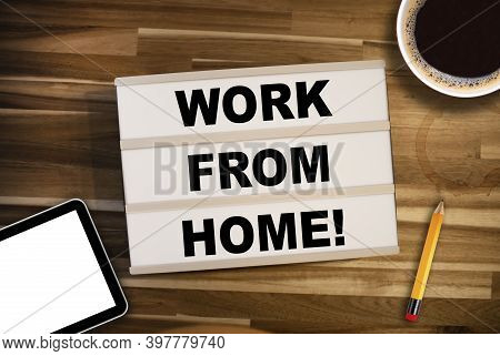 Lightbox Or Light Box With Message Homeoffice Work From Home On A Wooden Table With Cup Of Coffee