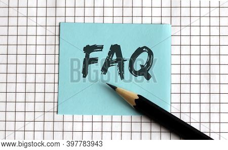 Faq , The Phrase Is Written On Colored Stickers, On A Notepad Background. Business