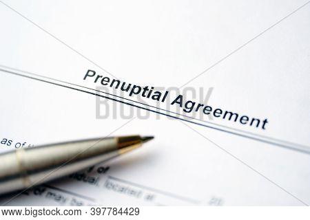Legal Document Prenuptial Agreement On Paper Near Pen.