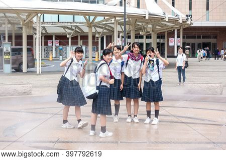 Oita, Kyushu, Japan August 04,2017: Young Japanese Schoolgirls Have Fun On The Way From School On Th