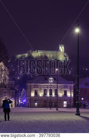 Ljubljana, Slovenia - December 2, 2020: Slovenian Philharmonic And Ljubljana Castle From Congress Sq