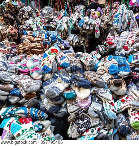 Moscow, Russia, June 16, 2019: A Large Pile Of Woolen Socks. Wool Products In The Clothing Market.